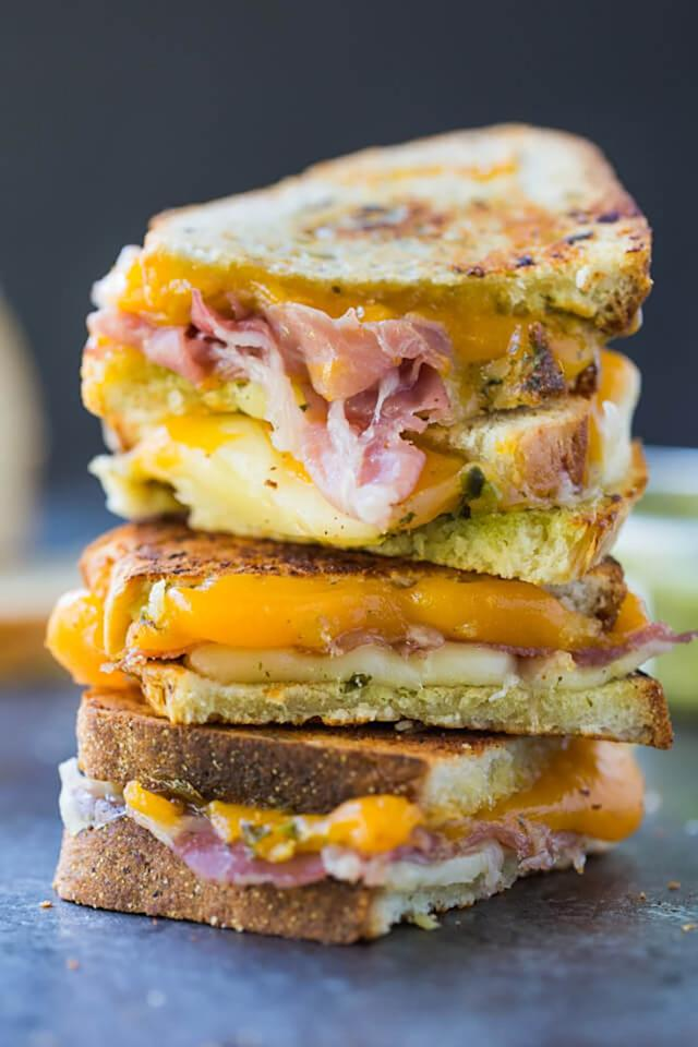"""<p>Prosciutto is ham's fancier, even more savory cousin. Add two types of cheese—fontina and cheddar—plus pesto for a decadent treat. Get the recipe <a rel=""""nofollow"""" href=""""http://www.azestybite.com/pesto-prosciutto-grilled-cheese-sandwich?mbid=synd_yahoofood"""">here</a>.</p>"""