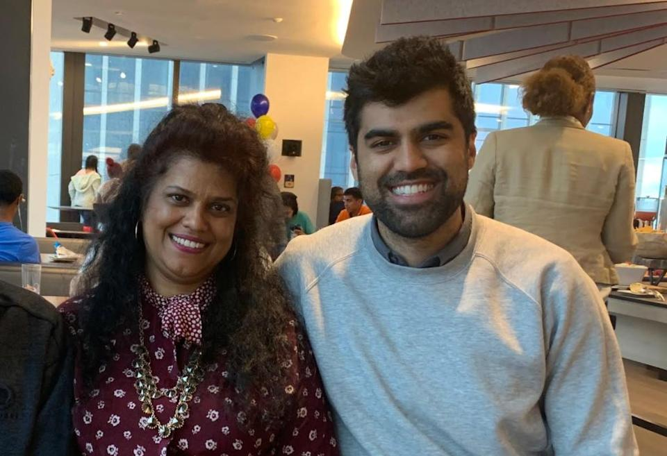 The author with his mom at a family day at the law firm where he worked in New York City in 2019.  (Photo: Courtesy of Ravi Guru Singh)