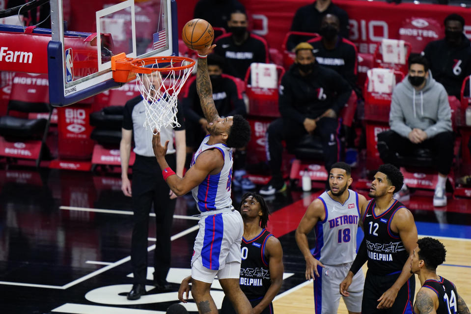 Detroit Pistons' Saddiq Bey, left, goes up for a shot past Philadelphia 76ers' Tyrese Maxey during the second half of an NBA basketball game, Saturday, May 8, 2021, in Philadelphia. (AP Photo/Matt Slocum)