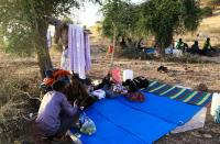 Ethiopians who fled war in Tigray region, rest under trees with their belongings at the Um-Rakoba camp on the Sudan-Ethiopia border in Al-Qadarif state