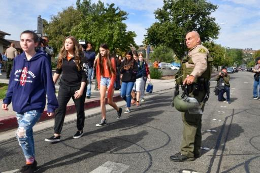 Students line up after a shooting at Saugus High School in Santa Clarita, California