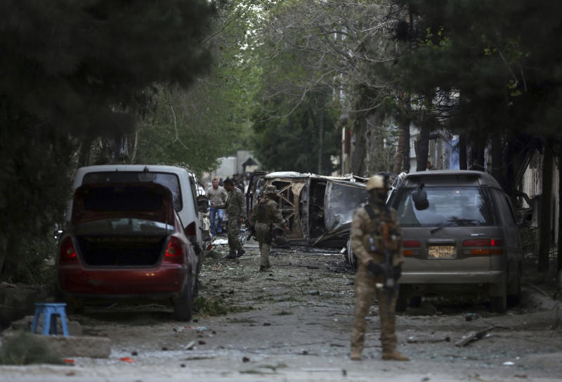 Afghan security forces guard the site of an explosion in Kabul, Afghanistan, Wednesday, May 8, 2019. The Taliban attacked the offices of an international NGO in the Afghan capital, setting off a huge explosion and battling Afghan security forces in an assault that killed at least five people, interior ministry said in a statement. The Ministry spokesman says over 20 Afghans were wounded in the attack. (AP Photo/Rahmat Gul)