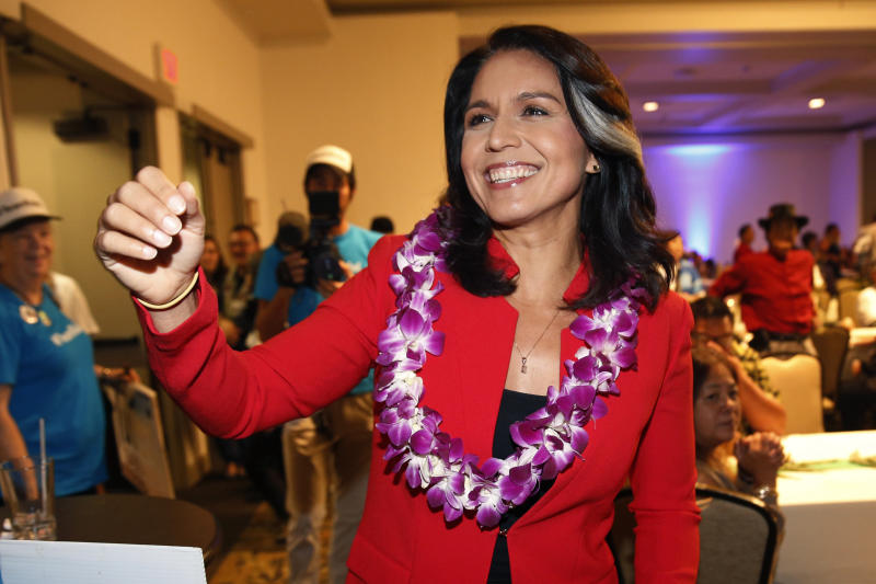 FILE - In this Nov. 6, 2018, file photo, Rep. Tulsi Gabbard, D-Hawaii, greets supporters in Honolulu. The 2020 presidential election already includes more than a half-dozen Democrats whose identities reflect the nation's growing diversity, as well as embody the coalition that helped Barack Obama first seize the White House in 2008 (AP Photo/Marco Garcia, File)