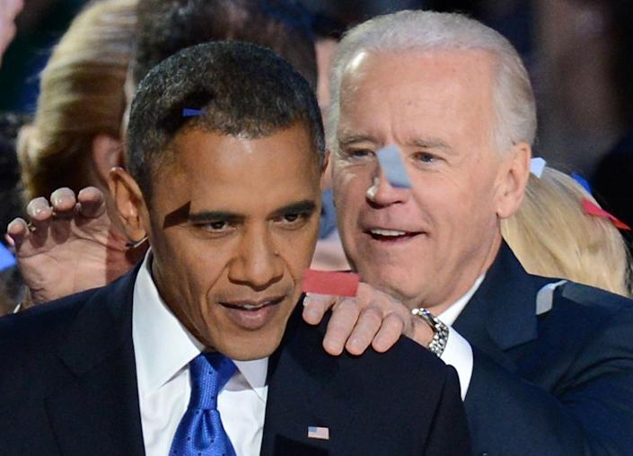 US President Barack Obama and Vice President Joe Biden celebrate winning the 2012 US presidential election November 7, 2012 in Chicago, Illinois.  Obama swept to re-election, forging history again by defying the dragging economic recovery and high unemployment which haunted his first term to beat Republican Mitt Romney.   AFP PHOTO / Saul LOEB        (Photo credit should read SAUL LOEB/AFP/Getty Images)