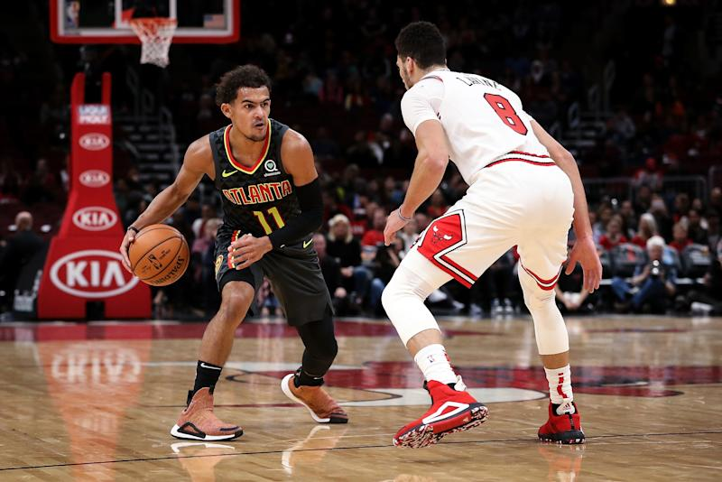 CHICAGO, ILLINOIS - OCTOBER 17: Trae Young #11 of the Atlanta Hawks dribbles the ball while being guarded by Zach LaVine #8 of the Chicago Bulls in the first quarter during a preseason game at the United Center on October 17, 2019 in Chicago, Illinois. NOTE TO USER: User expressly acknowledges and agrees that, by downloading and/or using this photograph, user is consenting to the terms and conditions of the Getty Images License Agreement. (Photo by Dylan Buell/Getty Images)