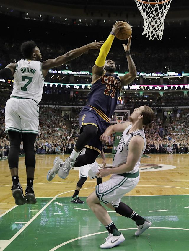 <p>Cleveland Cavaliers forward LeBron James (23) drives between Boston Celtics forward Jaylen Brown, left, and center Kelly Olynyk during the first quarter of Game 1 of the NBA basketball Eastern Conference finals, Wednesday, May 17, 2017, in Boston. (AP Photo/Charles Krupa) </p>