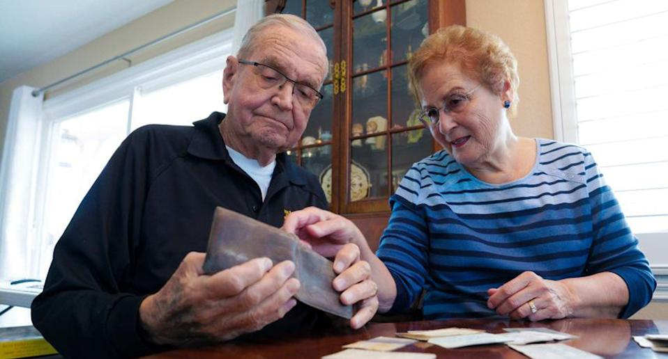 Paul Grisham (left) with his wife Carole Salazar (right) and the wallet he lost 53 years ago