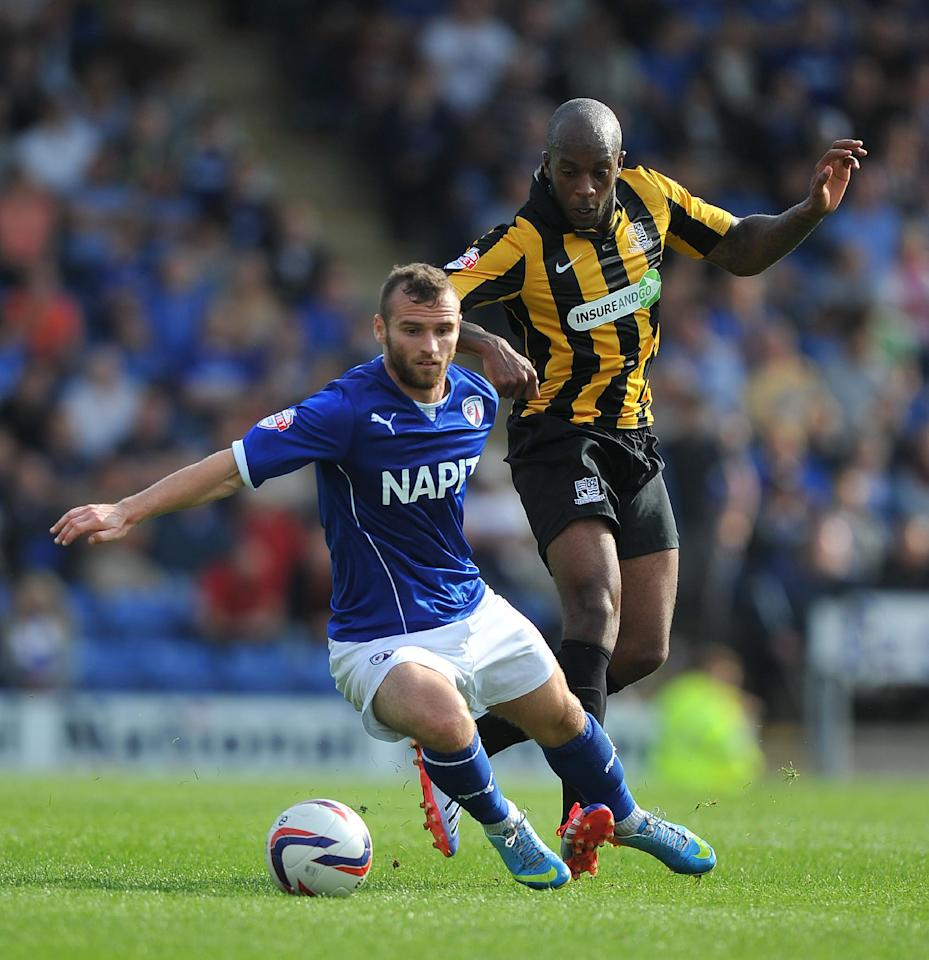 Chesterfield's Jimmy Ryan battles with Southend United's Anthony Straker during the Sky Bet Football League Two match at the Proact Stadium, Chesterfield.