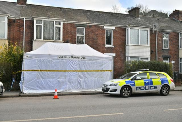 The scene outside 65 Bonhay Road, Exeter, where the body of Anthony Payne, 80, was discovered