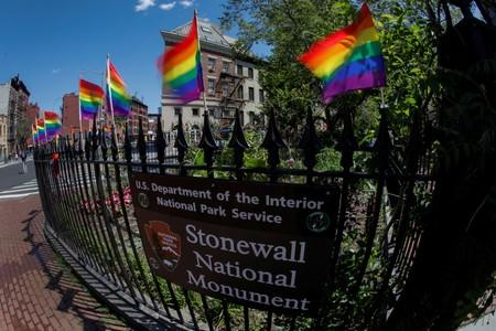 FILE PHOTO: Rainbow flags wave in the wind at the Stonewall National Monument outside the Stonewall Inn in New York