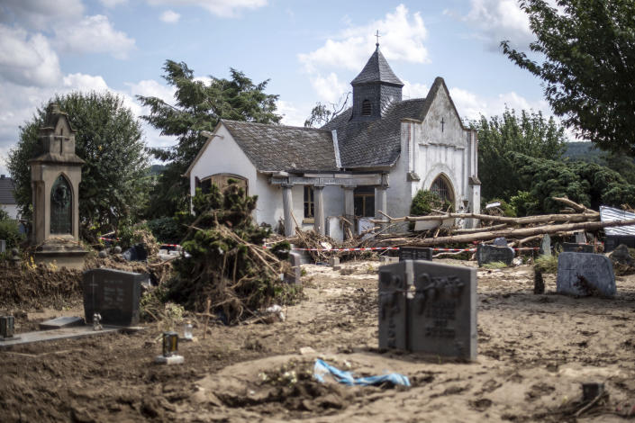 The cemetery with the mourning hall is devastated after the storm in BadmNeuenahr-Ahrweiler, Germany, Monday, Ju;ly 26, 2021. (Marius Becker/dpa via AP)