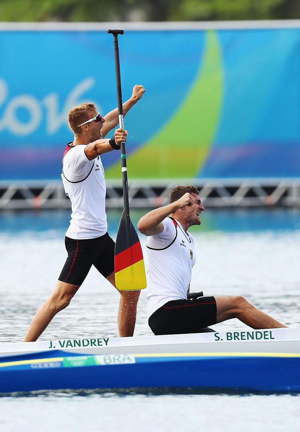 <p>Sebastian Brendel of Germany and Jan Vandrey of Germany celebrate winning the Men's Canoe Double 1000m on Day 15 of the Rio 2016 Olympic Games at the Lagoa Stadium on August 20, 2016 in Rio de Janeiro, Brazil. (Photo by Ryan Pierse/Getty Images) </p>