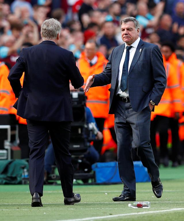 "Soccer Football - Premier League - West Ham United vs Everton - London Stadium, London, Britain - May 13, 2018 Everton manager Sam Allardyce shakes the hand of West Ham United manager David Moyes after the match REUTERS/Eddie Keogh EDITORIAL USE ONLY. No use with unauthorized audio, video, data, fixture lists, club/league logos or ""live"" services. Online in-match use limited to 75 images, no video emulation. No use in betting, games or single club/league/player publications. Please contact your account representative for further details."