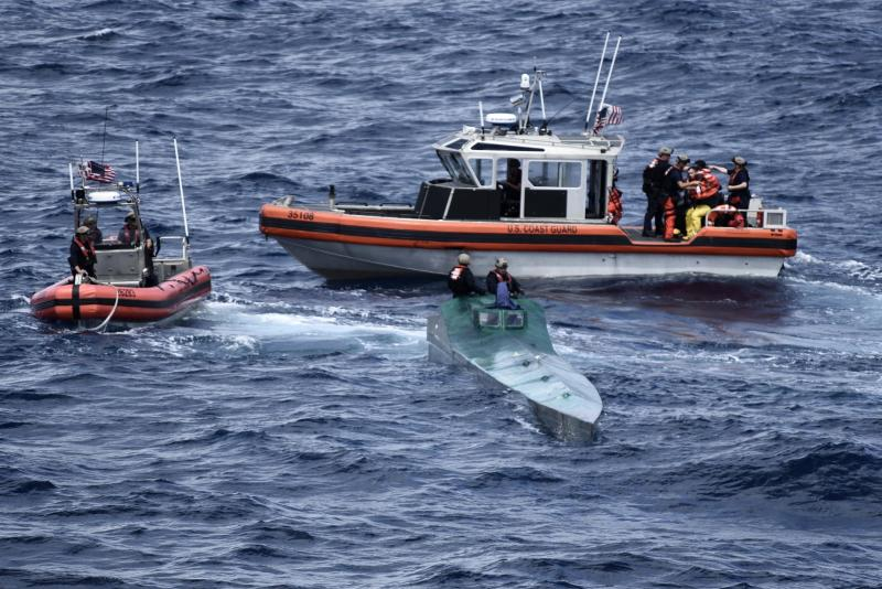 In this Nov. 4, 2019 photo provided by the U.S. Coast Guard, Coast Guard Cutter Bertholf (WMSL 750) boarding teams interdict a low-profile go-fast vessel while patrolling international waters of the Eastern Pacific Ocean, seizing more than 3,100 pounds of suspected cocaineAn estimated $312 million worth of cocaine seized from smugglers in the eastern Pacific Ocean has been brought to San Diego. About 18,000 pounds (8,165 kilograms) of the drug was offloaded Wednesday, Dec. 18, 2019, from the Coast Guard cutter Bertholf. (Petty Officer 2nd Class Paul Krug/U.S. Coast Guard via AP)