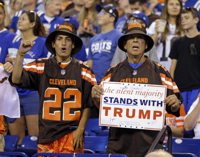 <p>Cleveland Browns fans hold a sign following the national anthem before an NFL football game between the Indianapolis Colts and the Cleveland Browns in Indianapolis, Sept. 24, 2017. (Photo: Michael Conroy/AP) </p>