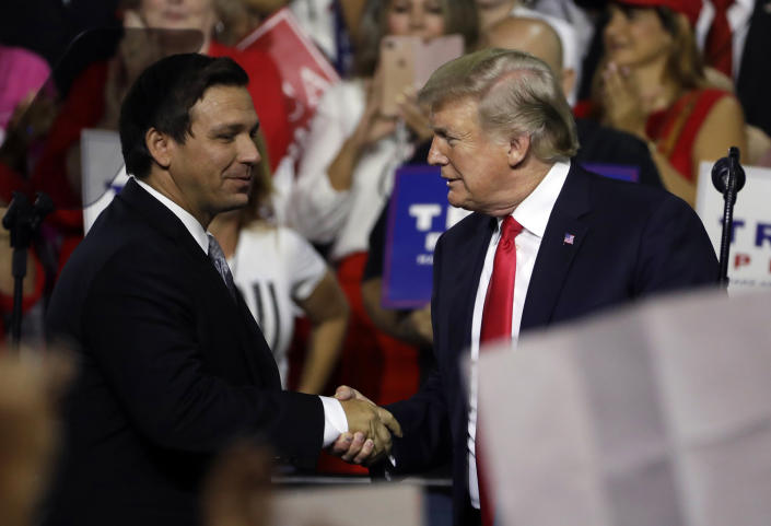 President Donald Trump shakes hands with DeSantis during a rally in Tampa, Fla., in July 2018.