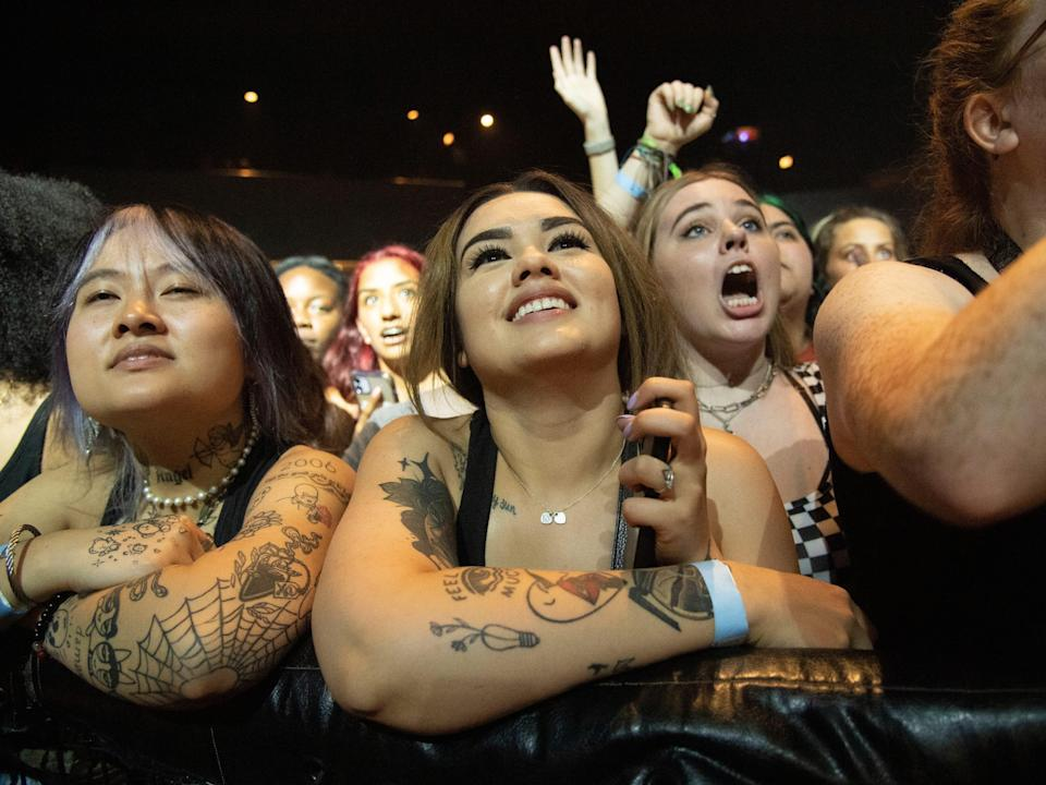 Festival goers attend Official Lollapalooza Aftershow, watching performance by Max.