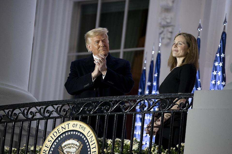 US President Donald Trump stands with newly sworn in Supreme Court Justice Amy Coney Barrett: Getty Images