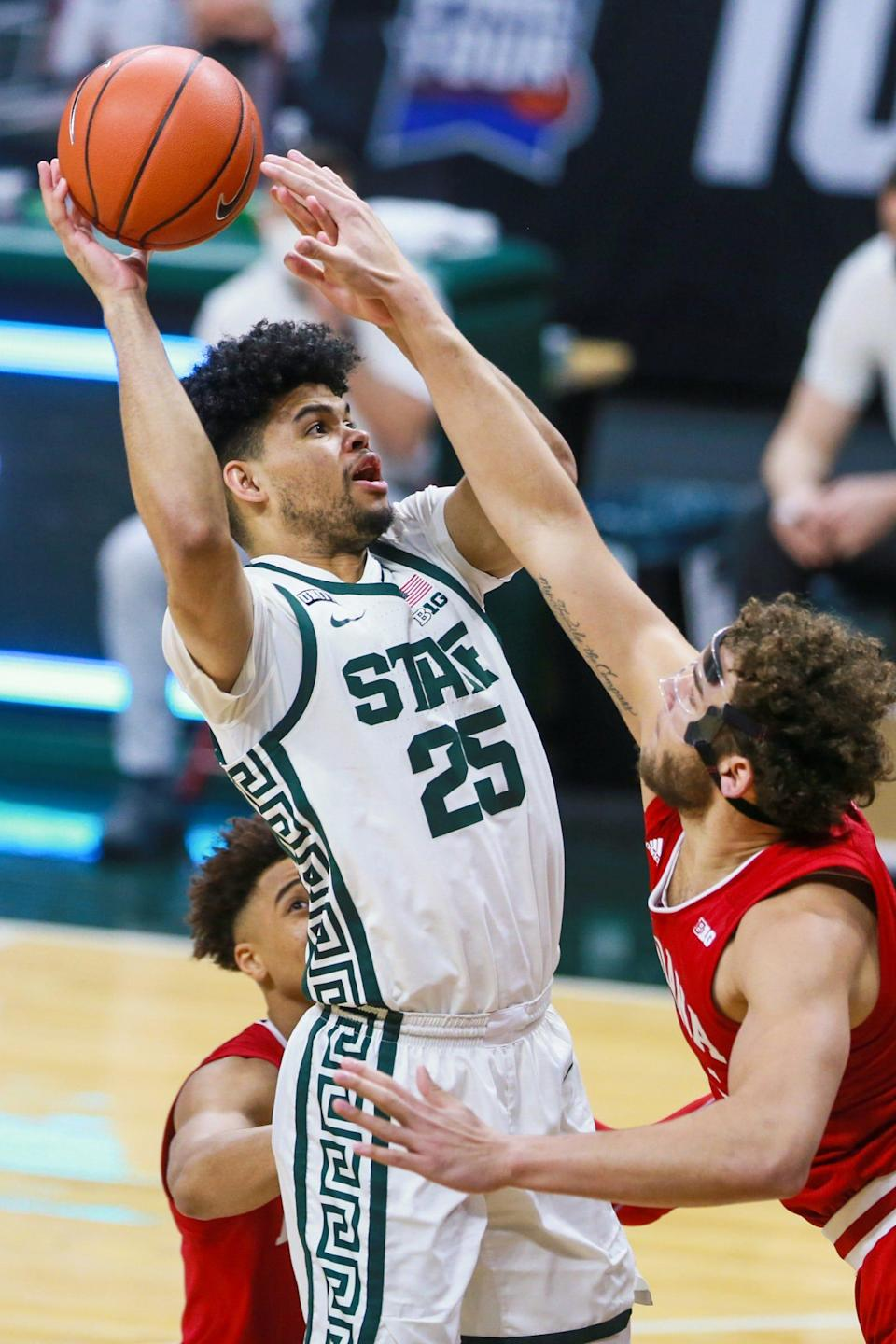 Michigan State forward Malik Hall (25) attempts a layup in the first half against Indiana on Tuesday, March 2, 2021, in East Lansing.