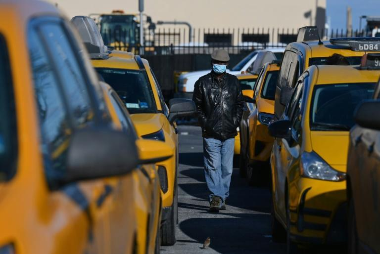 A yellow cab driver waits to pick up a customer at La Guardia airport in New York on February 4, 2021