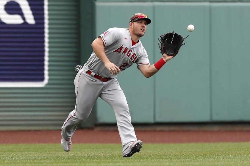 Los Angeles Angels' Mike Trout makes the catch on the line out by Boston Red Sox's J.D. Martinez.
