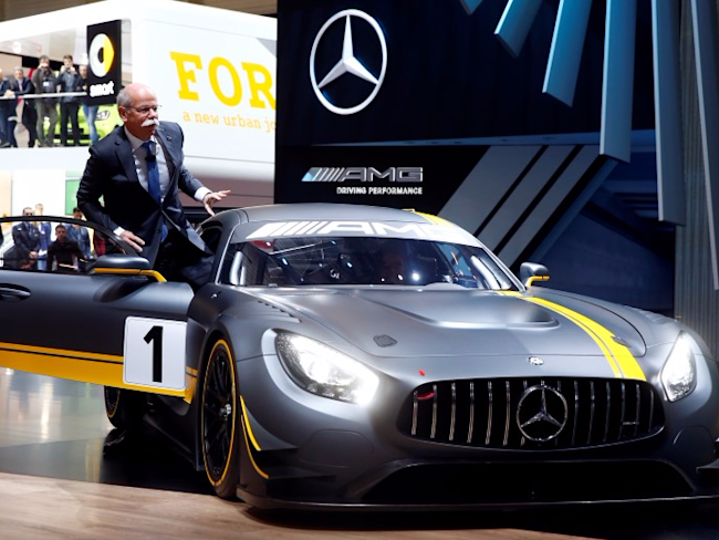 Daimler CEO Dieter Zetsche presents the new Mercedes-AMG GT3 race car during the first press day ahead of the 85th International Motor Show in Geneva March 3, 2015. REUTERS/Arnd Wiegmann
