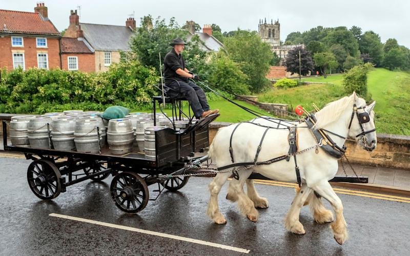 Samuel Smith's brewery in Tadcaster delivers beer to local pubs by horse-drawn cart - PA