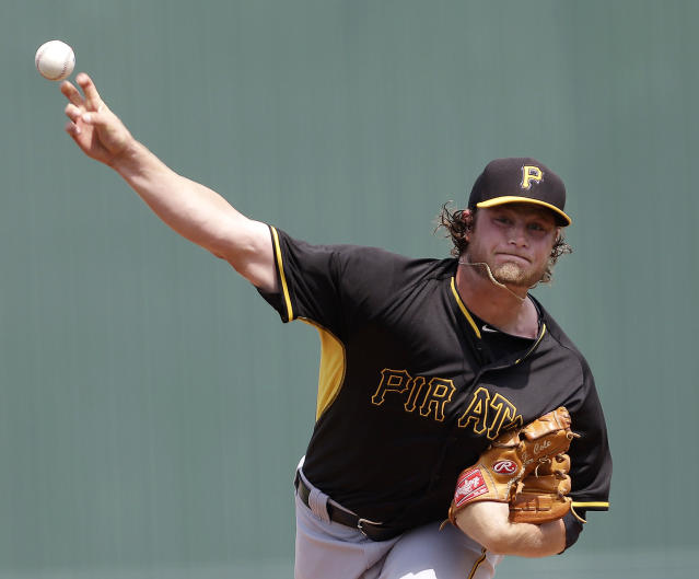 CORRECTS PITCHER TO GERRIT COLE, INSTEAD OF JEFF LIVESEY - Pittsburgh Pirates starter Gerrit Cole pitches in the first inning during an exhibition baseball game against the Minnesota Twins in Fort Myers, Fla., Wednesday, March 12, 2014. (AP Photo/Gerald Herbert)