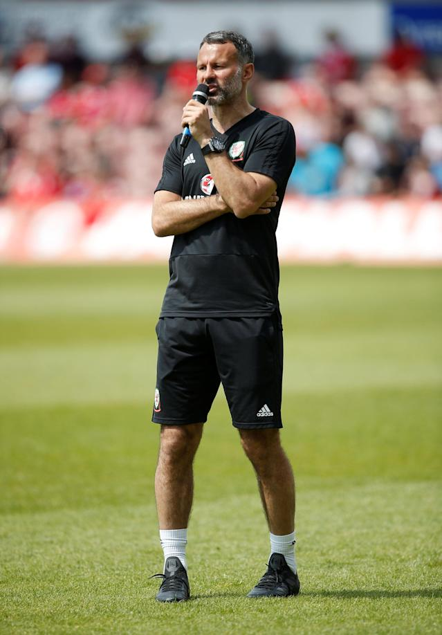 Soccer Football - Wales Training - The Racecourse, Wrexham, Britain - May 21, 2018 Wales manager Ryan Giggs speaks through a microphone during training Action Images via Reuters/Craig Brough
