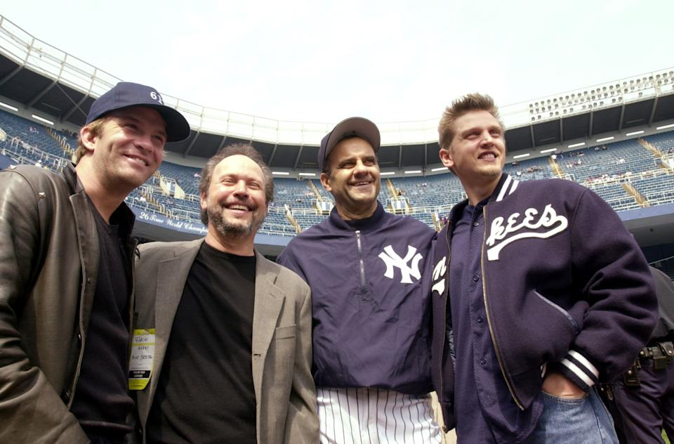 UNITED STATES - CIRCA 2001:  New York Yankees' manager Joe Torre is joined by (from left) Thomas Jane, Billy Crystal and Barry Pepper at Yankee Stadium. Crystal directed the TV movie