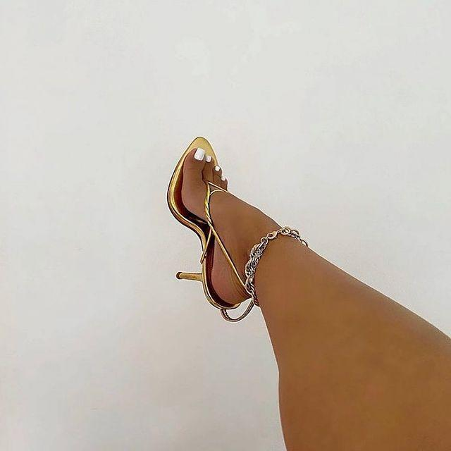 """<p>ByDose's simple strap sandals have a chic barely-there feel, while remaining incredibly striking. Their metallic pumps are truly a fashion treasure. </p><p><a class=""""link rapid-noclick-resp"""" href=""""https://www.by-dose.com/"""" rel=""""nofollow noopener"""" target=""""_blank"""" data-ylk=""""slk:SHOP NOW"""">SHOP NOW</a></p><p><a href=""""https://www.instagram.com/p/CKjX6McFIeZ/"""" rel=""""nofollow noopener"""" target=""""_blank"""" data-ylk=""""slk:See the original post on Instagram"""" class=""""link rapid-noclick-resp"""">See the original post on Instagram</a></p>"""