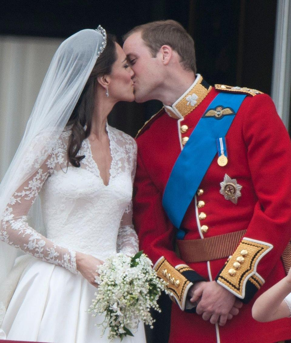 <p>The pair shared their first kiss as a couple on the balcony of Buckingham Palace, per tradition.</p>