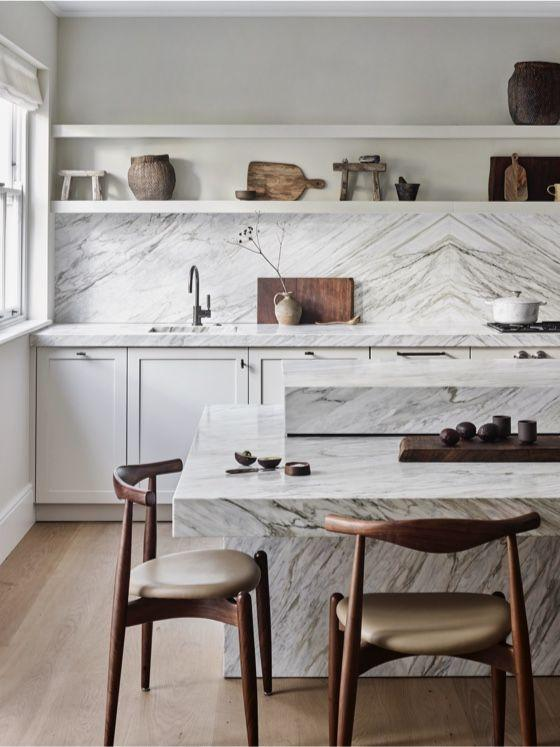 """<p>For a sustainable and sophisticated take on the white kitchen, avoid the synthetic materials we're so accustomed to seeing in kitchens. Clear your counters of plastic, and instead, display interesting wood artefacts, clay pots, and stoneware.</p><p>Pictured: <a href=""""https://roundhousedesign.com/design-collection/kitchen-type/classic/sondergaard-kitchen/"""" rel=""""nofollow noopener"""" target=""""_blank"""" data-ylk=""""slk:Sondergaard kitchen by Roundhouse"""" class=""""link rapid-noclick-resp"""">Sondergaard kitchen by Roundhouse</a></p>"""