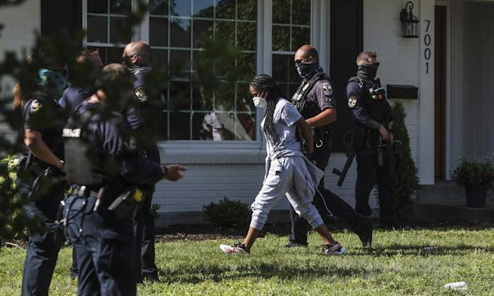 """<span class=""""element-image__caption"""">A protester is arrested on 15 July after sitting in the front yard of Kentucky's attorney general, Daniel Cameron, in Louisville, chanting Breonna Taylor's name.</span> <span class=""""element-image__credit"""">Photograph: Mary Ann Gerth/AP</span>"""