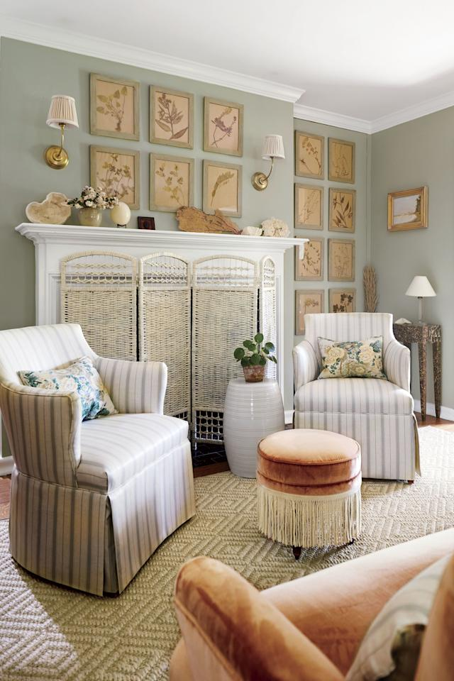 <p>A white wicker screen matches the cottagey décor of this home's living room. It's both practical and stylish.</p>