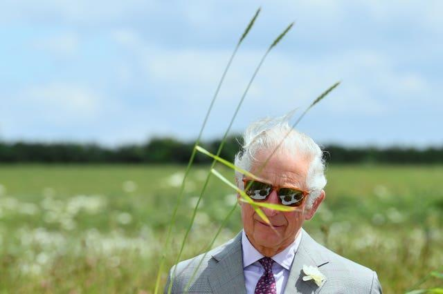 The Prince of Wales views soil samples during his visit to the specialist farming centre