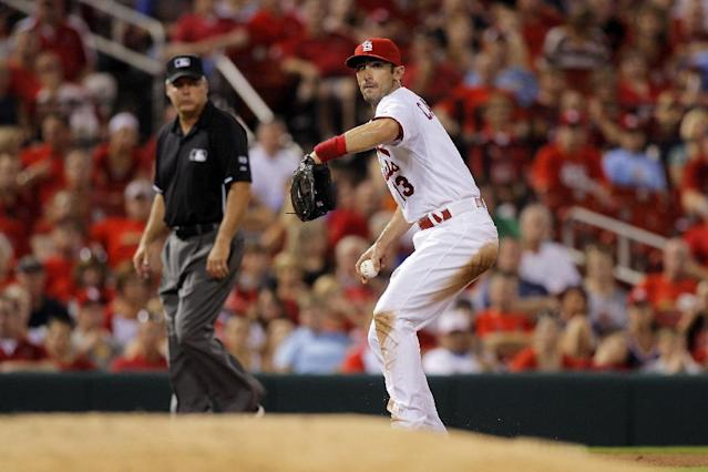 St. Louis Cardinals third baseman Matt Carpenter throws to first for an out against Cincinnati Reds' Brandon Phillips during the sixth inning of a baseball game Tuesday, Aug. 19, 2014, in St. Louis. (AP Photo/Scott Kane)