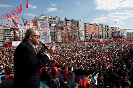 FILE PHOTO: Erdogan addresses his supporters during a rally for the upcoming referendum, in Izmir