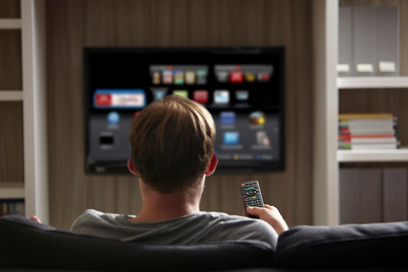A man watches television on a smart TV in this undated stock photo. The FBI says it's important to know your TV's capabilities before buying one. (Photo: iStockphoto/Getty Images)