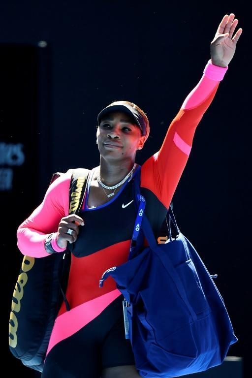 Serena Williams waves as she walks off Rod Laver Arena
