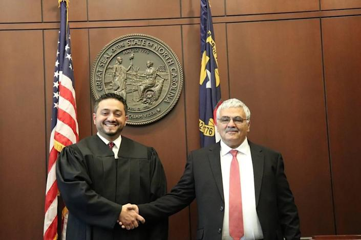 District Court Judge Rashad Hauter poses with his father, Ahmed, who brought him to the US from Yemen at age 3. Hauter is the country's first Yemeni-born judge.