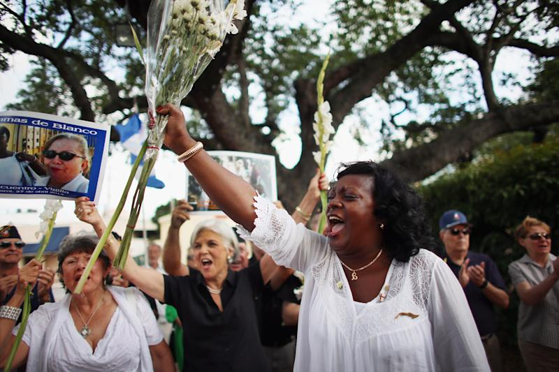 Berta Soler, co-founder of the Ladies in White, and current leader of the Cuban opposition group leads a cheer as she visits with Cuban exiles during an event at Merrick Park on April 27, 2013 in Coral Gables, Florida (AFP Photo/Joe Raedle)