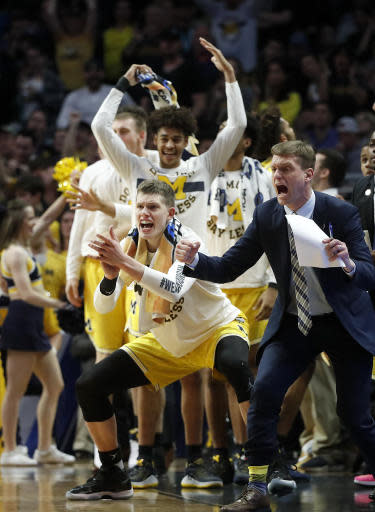 Michigan players celebrate a score during the second half of the team's NCAA men's college basketball tournament regional final against Florida State on Saturday, March 24, 2018, in Los Angeles. (AP Photo/Jae Hong)