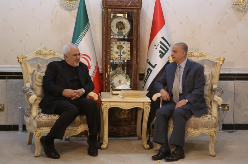 Iraqi Foreign Minister Mohamed Alhahkim, right, meets with his visiting Iranian counterpart Mohammad Javad Zarif at the Ministry of Foreign Affairs in Baghdad, Iraq, Sunday, May 26, 2019. (AP Photo/Khalid Mohammed)