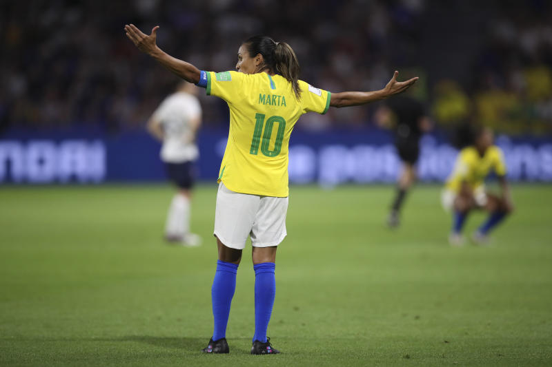 Brazil's Marta opens her arms at the end of the Women's World Cup round of 16 soccer match between France and Brazil at the Oceane stadium in Le Havre, France, Sunday, June 23, 2019. France beat Brazil 2-1. (AP Photo/Francisco Seco)