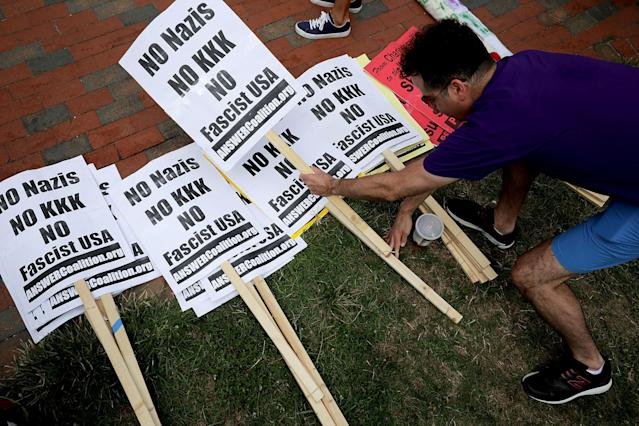 "<p>Demonstrators select anti-KKK signs ahead of the planned white supremacist Unite the Right rally in Lafayette Park rally across from the White House August 12, 2018 in Washington, DC. Thousands of protesters are expected to demonstrate against the ""white civil rights"" rally, which was planned by the organizer of last yearÕs deadly rally in Charlottesville, Virginia. (Photo: Chip Somodevilla/Getty Images) </p>"