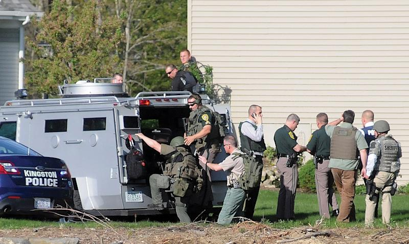 Police officers prepare to enter an armored vehicle near the Nolan family home in Brentwood, N.H., Monday May 12, 2014. Brentwood police officer Steven Arkell was allegedly shot to death by Michael Nolan, when he answered a call in a Nolan's suburban neighborhood, according to the New Hampshire Attorney General Joseph Foster. (AP Photo/The Portsmouth Herald, Deb Cram)
