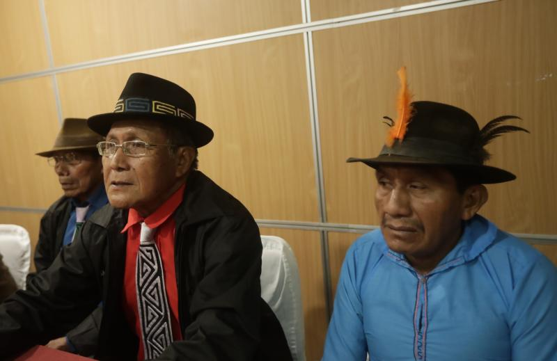 "Guna indigenous leaders and representatives, from left, Mario Perez, Belisario Lopez and Ebertino Perez, give a press conference to demand that Nike remove their community's traditional Mola handcraft pattern from one of the company's shoe designs, in Panama City, Tuesday, May 21, 2019. Nike said in a statement that it has canceled the launch of the ""Nike Air Force 1 'Puerto Rico"" trainer, with which it intended to pay homage to Puerto Rico. (AP Photo/Arnulfo Franco)"