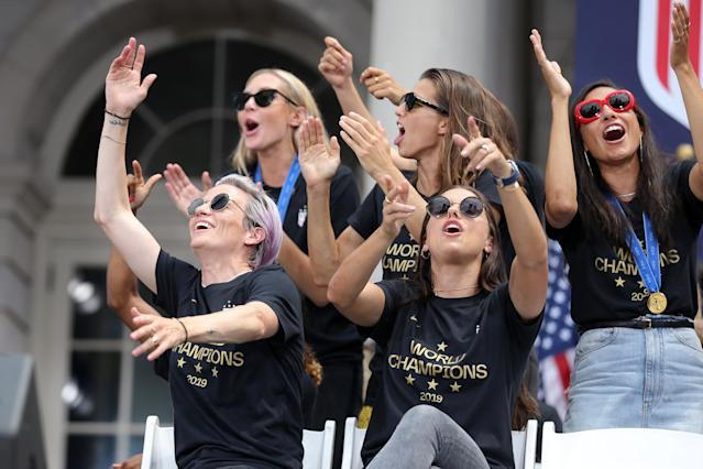 The World Cup champs sipped champagne, erupted in dance moves and hopped on floats during the ticker-tape parade in their honor.