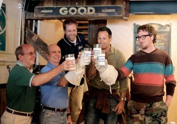 """Team members from Dogfish Head Craft Brewery and ILC Dover toast """"Celest-jewel-ale,"""" made with moon dust."""